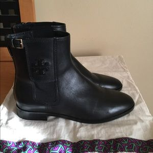 Tory Burch black leather pull on booties.